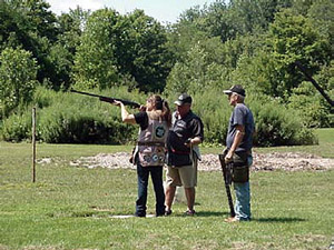Doug Thompson giving tips and needed instruction to Barker shooters Tina Roberts and Rich Burley.